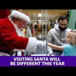 Santa takes precautions as visitors flock to see him amid the coronavirus pandemic